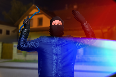 burglar-hands-up-caught